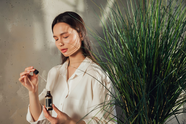 woman with an esesntial oil