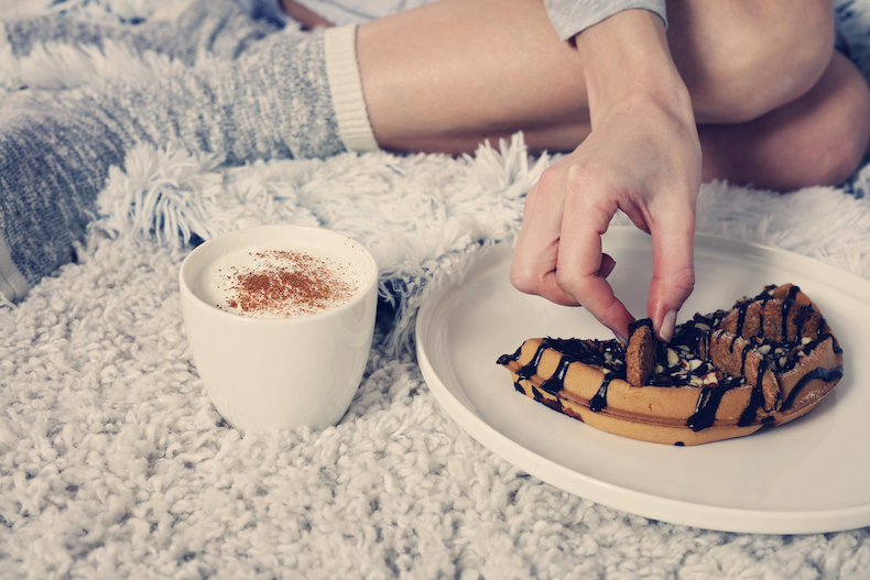 A woman enjoying coffee and cake